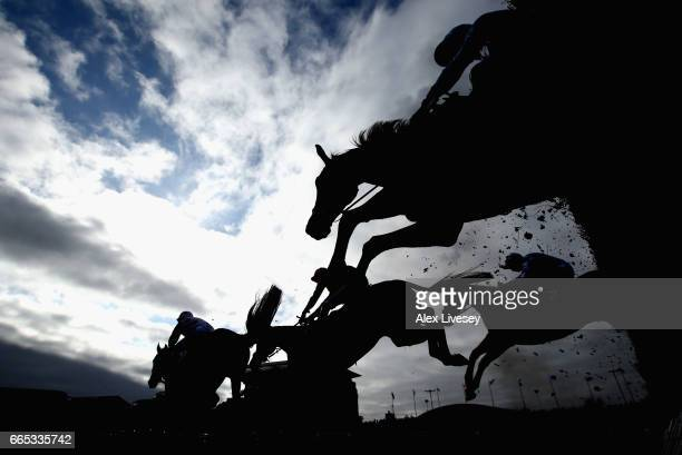 Horses clear a fence during the Betway Red Rum Handicap Steeple Chase at Aintree Racecourse on April 6 2017 in Liverpool England