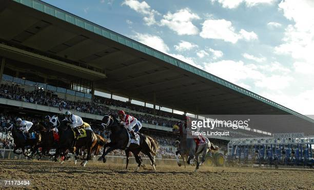Horses come out of the gate to start the 138th running of the Belmont Stakes on June 10 2006 at Belmont Park in Elmont New York