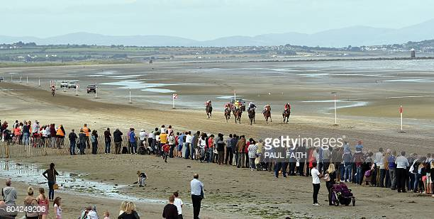 Horses compete on the course on Laytown beach in County Meath on the east coast of Ireland on September 13 2016 during the Laytown Strand horse races...