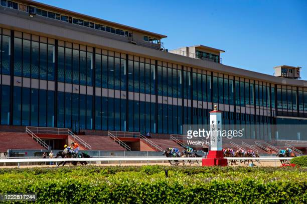 Horses crossing the finish line with empty stands on Derby Day at Oaklawn Racing Casino Resort on May 2 2020 in Hot Springs Arkansas
