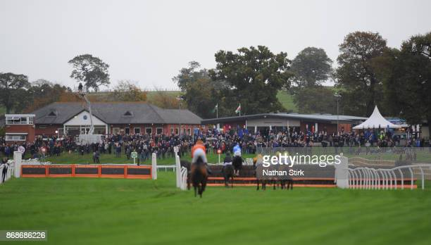 Horses gallop during The Order Timeform Jumps Horses to Follow Handicap Hurdle Race at BangorOnDee Racecourse on October 31 2017 in Bangor Wales