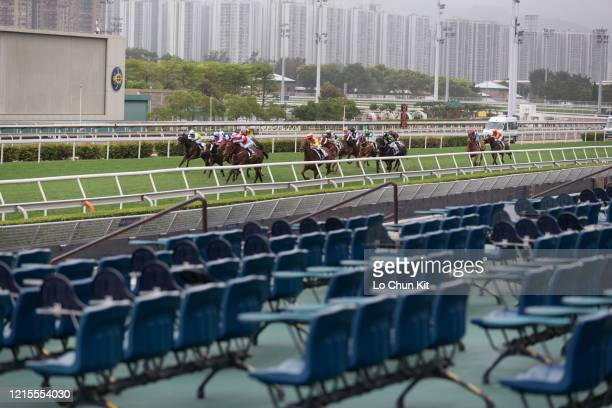 March 29 : Horses gallop past the empty public stand at Sha Tin Racecourse during the Race 7 Cheung Sha Wan Handicap on March 29, 2020 in Hong Kong....