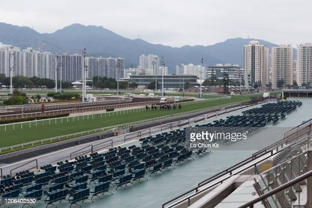 February 8 : Horses gallop past the empty public stands at Sha Tin Racecourse during Race 5 Lok Fu Handicap on February 8 , 2020 in Hong Kong. A...