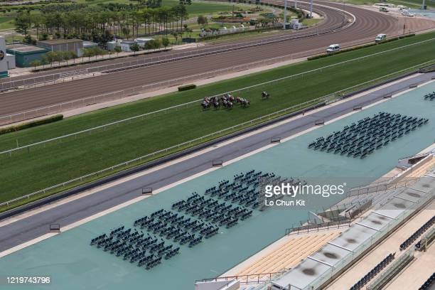 April 19 : Horses gallop past the empty public stands at Sha Tin Racecourse during the Race 1 Waterloo Handicap on April 19, 2020 in Hong Kong. The...