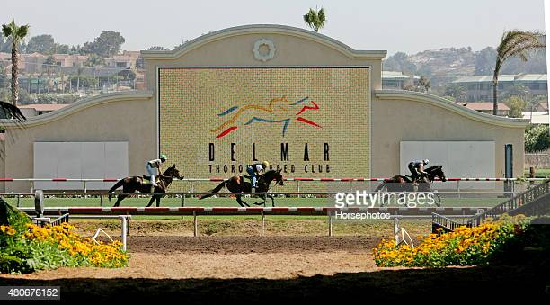 Horses galloping in front of Del Mar Race Track jumbotron and Del Mar logo July 20 2004
