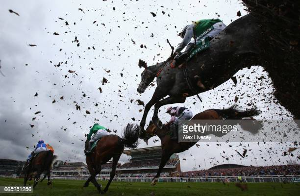 Horses jump a fence during the Manifesto Novices' Steeple Chase at Aintree Racecourse on April 6 2017 in Liverpool England