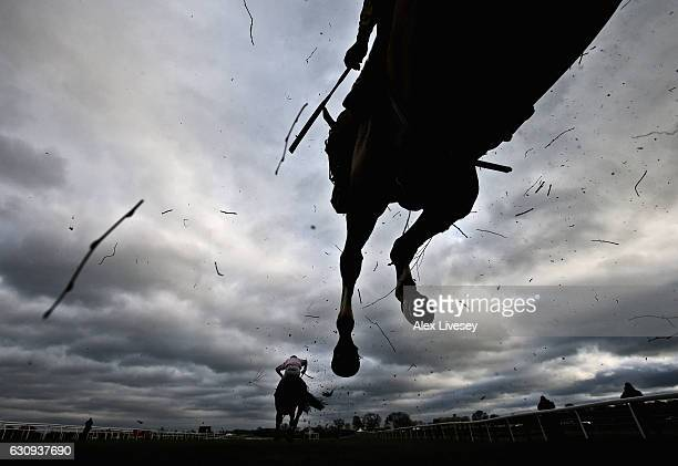 Horses jump a fence during the Stella Artois Supporting Bangor Handicap Steeple Chase at BangorOnDee Racecourse on January 3 2017 in Bangor Wales