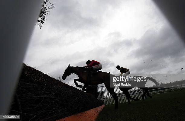 Horses jump the last fence in The STP Construction Handicap Steeple Chase race at Newcastle racecourse on November 28 2015 in Newcastle upon Tyne...