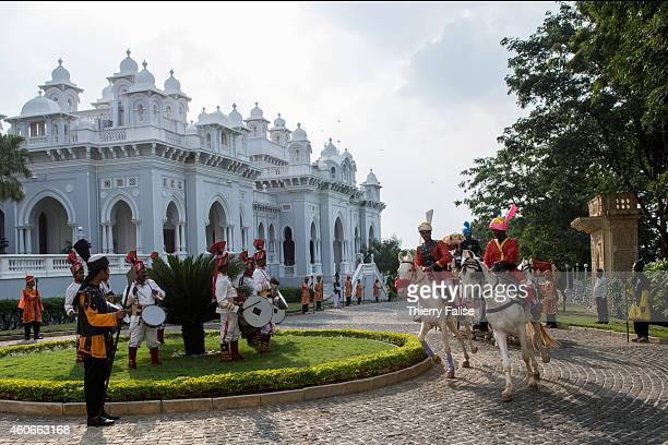 Horses leading a cart with guests arrive at the Taj Falaknuma Palace in Hyderabad The palace's construction started in 1884 and was completed in 1893...