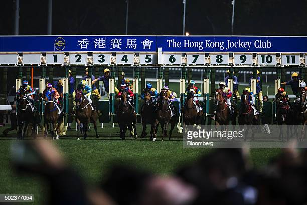 Horses leave the starting gate during a race at the Hong Kong Jockey Club's Happy Valley racecourse in Hong Kong China on Wednesday Dec 23 2015 The...