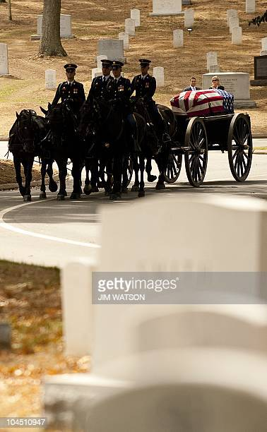 Horses pull the caisson which bears the casket of US Senator Ted Stevens during the full military honors funeral at Arlington National Cemetery in...