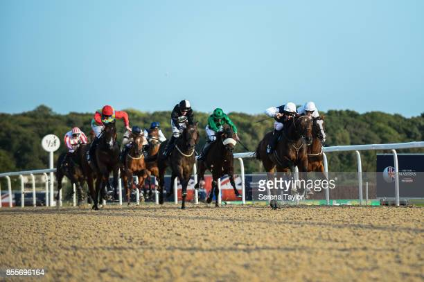 Horses race during the 125 Plate at the Newcastle Race Course on September 29 in Newcastle upon Tyne, England.