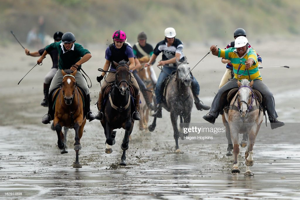 Horses race in the Wairarapa Station Hack Race during the Castlepoint Beach Races at Castlepoint Beach on March 2, 2013 in Masterton, New Zealand.