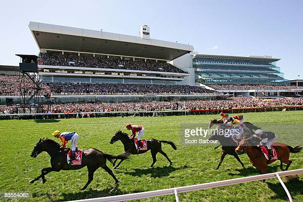 Horses race past the finishing post during the Emirates Melbourne Cup race during The Melbourne Cup Carnival meeting at Flemington Racecourse on...