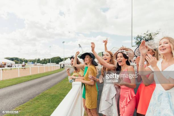 horses racing on ladies day - horse racing stock pictures, royalty-free photos & images