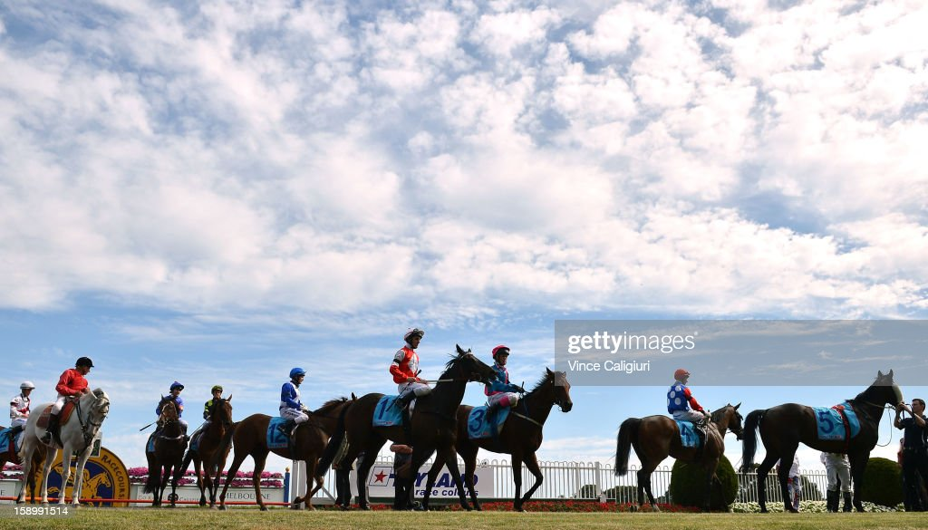 Horses return to the mounting yard after the Robert Hunter Handicap during Caulfield racing at Caulfield Racecourse on January 5, 2013 in Melbourne, Australia.