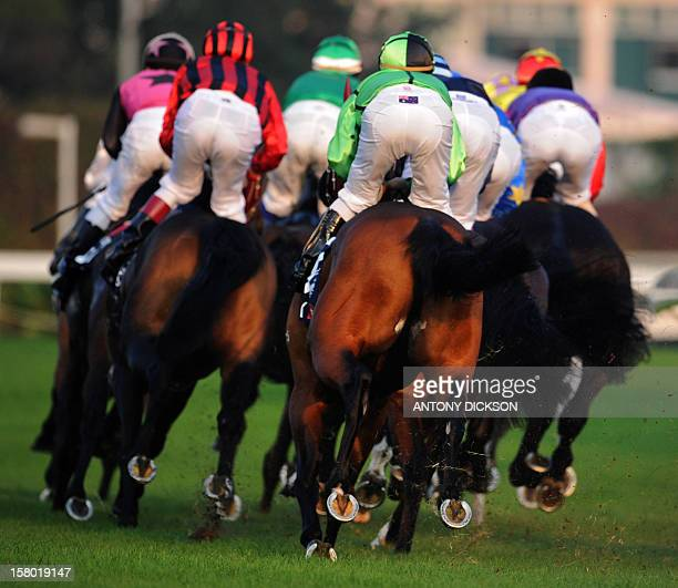 Horses round a bend in the 2000metre Longines Hong Kong Cup race at the Hong Kong International Races at the Shatin racecourse in Hong Kong on...