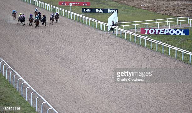 Horses run in The Lookers Land Rover of Bishops Stortford Handicap Stakes at Chelmsford City racecourse on February 01 2015 in Chelmsford England