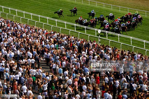 Horses run in The Weatherbys Super Sprint Stakes at Newbury Racecourse on July 21 2018 in Newbury United Kingdom