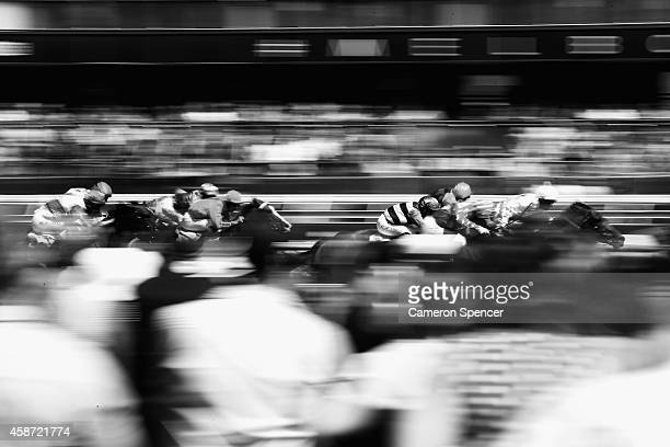 Horses sprint to the winning post on Oaks Day at Flemington Racecourse on November 6 2014 in Melbourne Australia