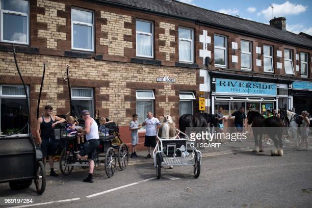 Horses tethered outside a fish and chips shop in the centre of Appleby-in-Westmorland on the opening day of the annual Appleby Horse Fair, in the...