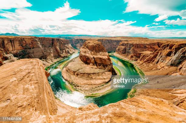 horseshoe bend ein sonniger tag im grand canyon - grand canyon stock-fotos und bilder