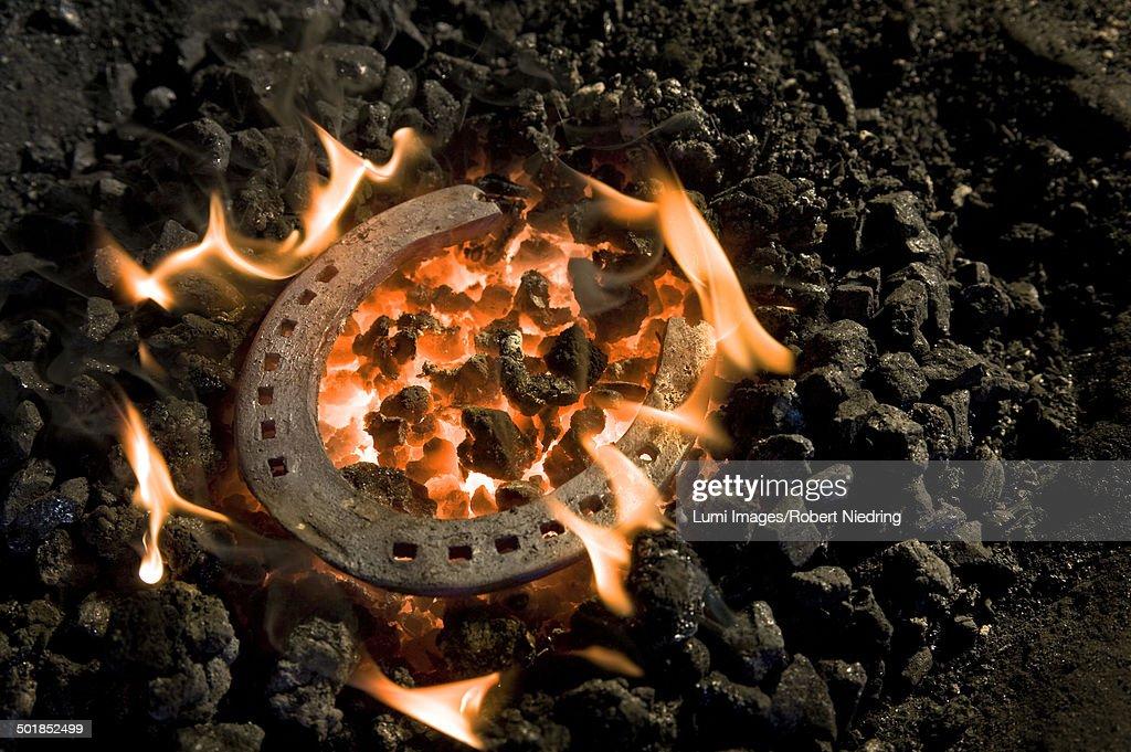 Horseshoe lying on burning coal, Landshut, Bavaria, Germany : Stock Photo