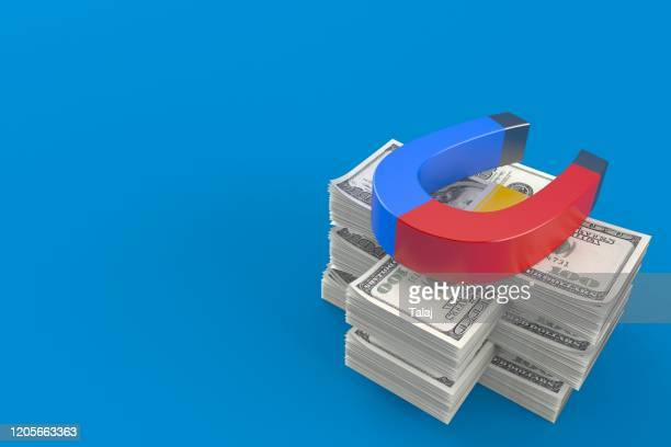 horseshoe magnet stack money isolated blue
