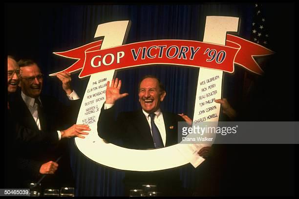 GOP VICTORY '90 horseshoeframed Gov cand Clayton Williams having ball at his campaign fundraiser w Pres Bush Sen Gramm