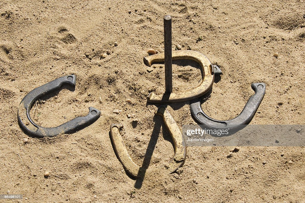 Horseshoes and stake : Stock Photo