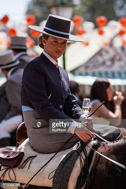 A horsewoman drinks at the quotFeria de Abrilquot Seville Spain 22 april 2015