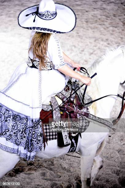 A horsewoman is seen on the runway during Christian Dior Couture S/S19 Cruise Collection show on May 25 2018 in Chantilly France