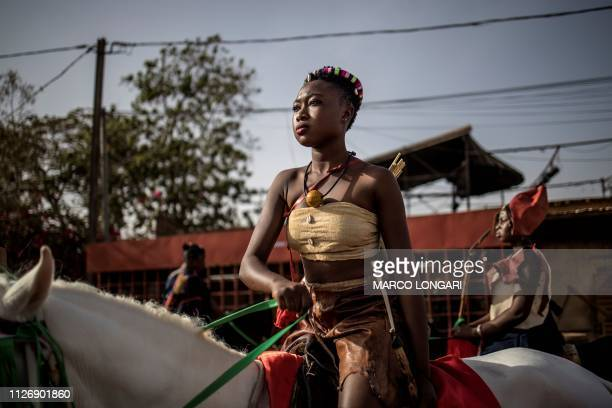 Horsewomen prepare to parade for the opening ceremony of the FESPACO Panafrican Film and Television Festival of Ouagadougou which is about to start,...