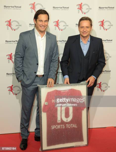 Horst Heldt and Gerhard Zuber pose at the 10th anniversary celebration of the Sports Total Agency on November 5 2017 in Cologne Germany