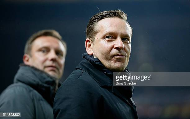 Horst Heldt manager of Schalke looks on prior to the Bundesliga match between Hertha BSC and FC Schalke 04 at Olympiastadion on March 11 2016 in...