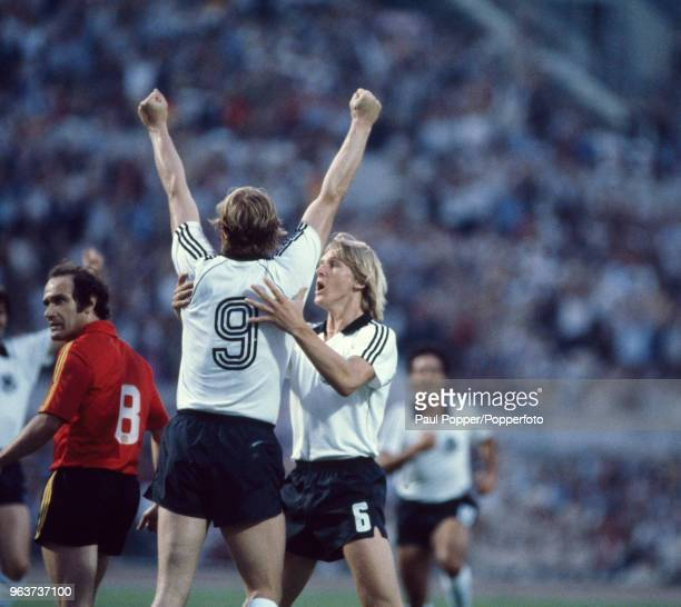 Horst Hrubesch of West Germany celebrates scoring with teammate Bernd Schuster during the UEFA Euro 1980 Final between Belgium and West Germany at...