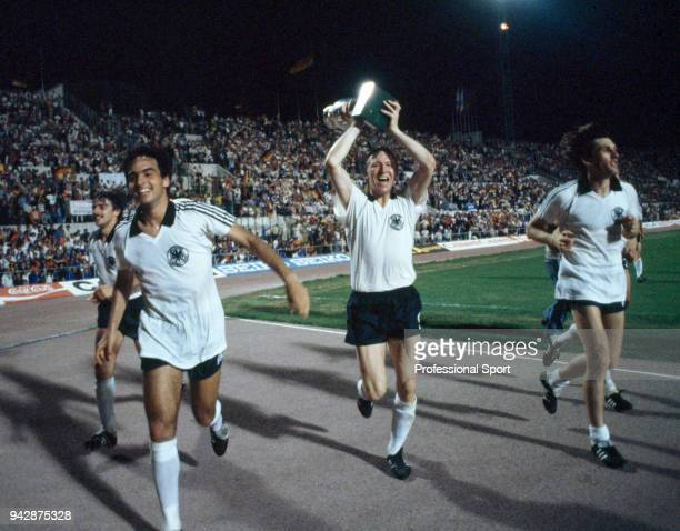 Horst Hrubesch of West Germany takes the trophy on a lap of honour after the UEFA Euro 1980 Final between Belgium and West Germany at the Stadio...