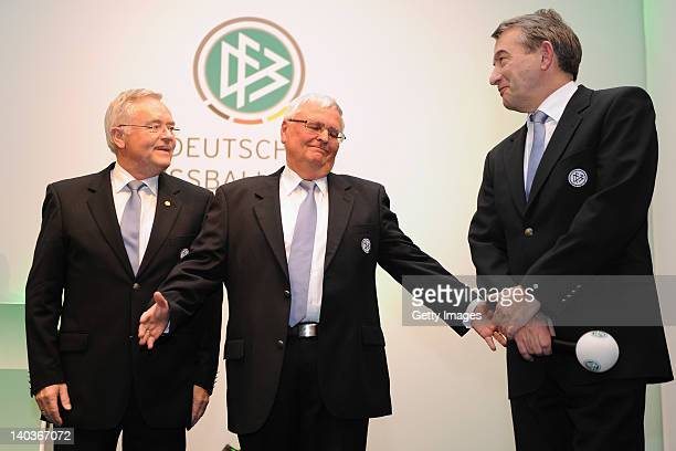 Horst R Schmidt former DFB president Theo Zwanziger and newly elected DFB president Wolfgang Niersbach stand on the stage during the DFB federal...