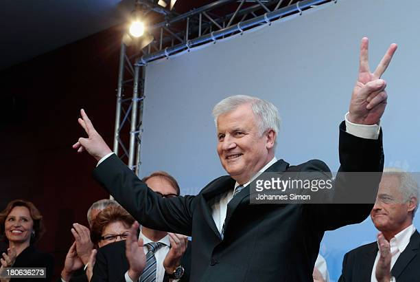 Horst Seehofer Chairman of the Bavarian Christian Democrats celebrates as speaking to supporters at the Bavarian state parliament after initial...