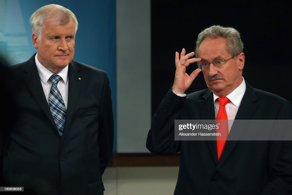 Horst Seehofer (L), Chairman of the Bavarian Christian Democrats (CSU) attends a TV interview with Christian Ude (SPD), Mayor of Munich, member of the German Social Democrats (SPD) and social democrats candidate for the bavarian election after initial results give the CSU 49% of votes cast in Bavarian state elections on September 15, 2013 in Munich, Germany. The outcome in Bavaria will be seen by many as an important indicator ahead of German federal elections scheduled for September 22.