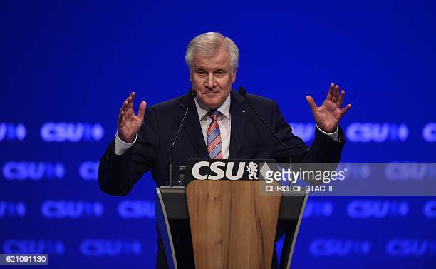 Horst Seehofer Chairman of the Christian Social Union Party gestures as he delivers his speech during the CSU party congress in Munich southern...