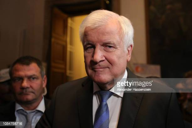 Horst Seehofer Chairman of the Christian Social Union political party is seen at the Bavarian state parliament after initial election results give...