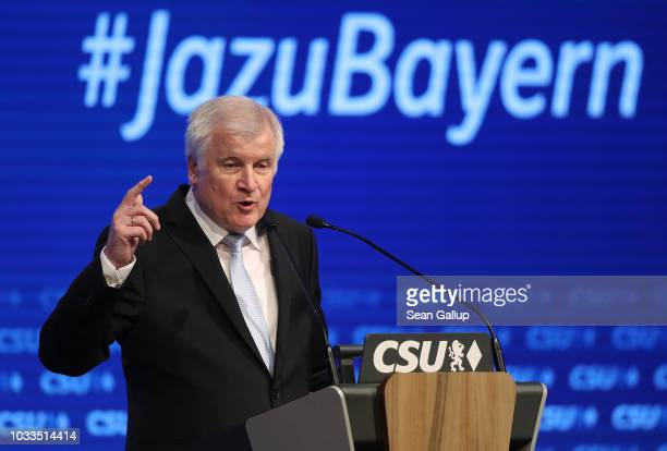 """Horst Seehofer, German Interior Minister and head of the Bavarian Social Union political party, speaks under a slogan that reads: """"Yes to Bavaria!""""..."""