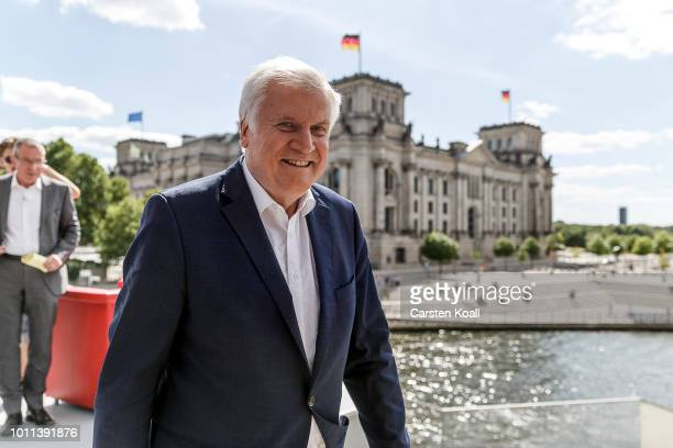 Horst Seehofer German Interior Minister and leader of the Bavarian Social Union political party leaves the stage after his summer interview with ARD...