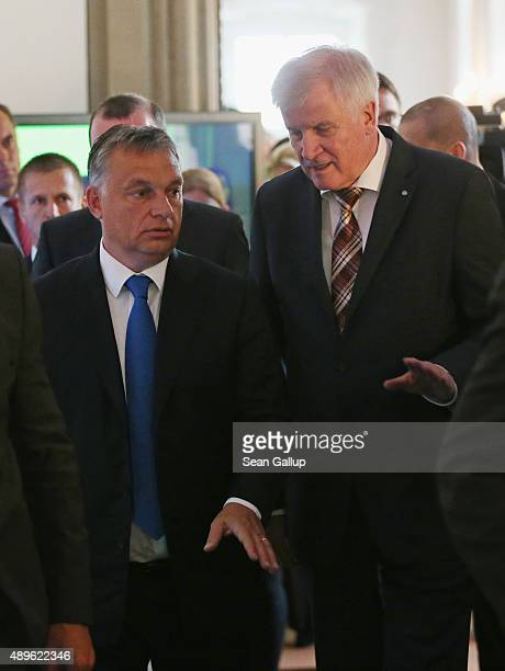 Horst Seehofer Governor of Bavaria and head of the Bavarian Christian Democrats and Viktor Orban Prime Minister of Hungary depart after speaking to...