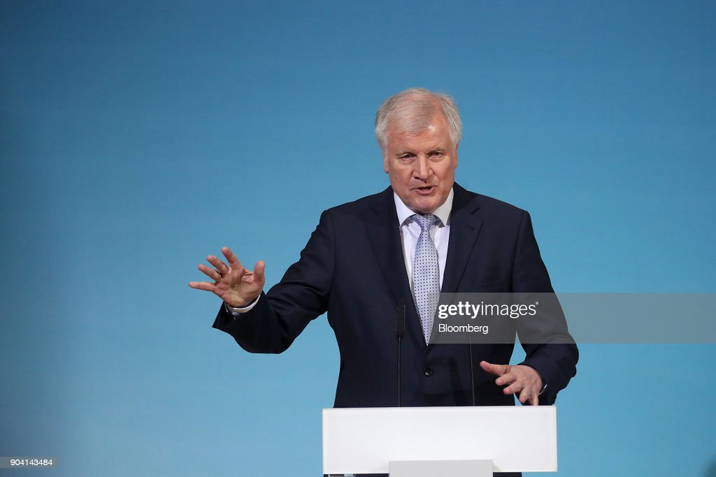 Horst Seehofer, leader of the Christian Social Union (CSU) party, gestures as he speaks during a news conference following overnight coalition negotiations, at the Social Democratic Party headquarters in Berlin, Germany, on Friday, Jan. 12, 2018. After a marathon of more than 24 hours of talks to end Germanys political gridlock, leaders of Merkels Christian Democratic Union, her Bavarian sister party and the Social Democrats hammered out a 28-page agreement. Photographer: Krisztian Bocsi/Bloomberg via Getty Images