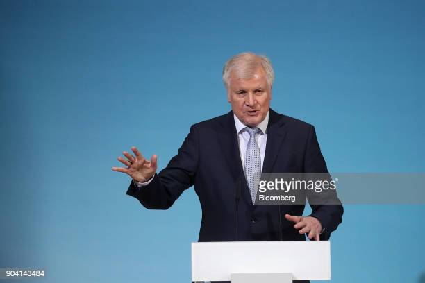 Horst Seehofer leader of the Christian Social Union party gestures as he speaks during a news conference following overnight coalition negotiations...
