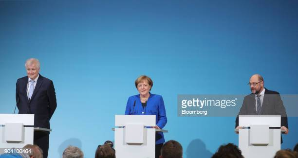 Horst Seehofer leader of the Christian Social Union party left and Angela Merkel Germany's chancellor center look on as Martin Schulz leader of the...