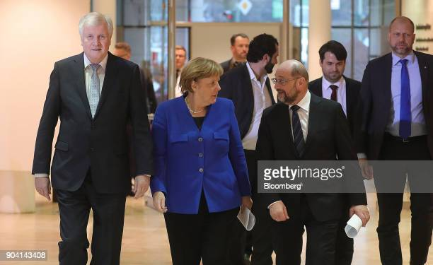 Horst Seehofer leader of the Christian Social Union party left and Angela Merkel Germany's chancellor center and Martin Schulz leader of the Social...