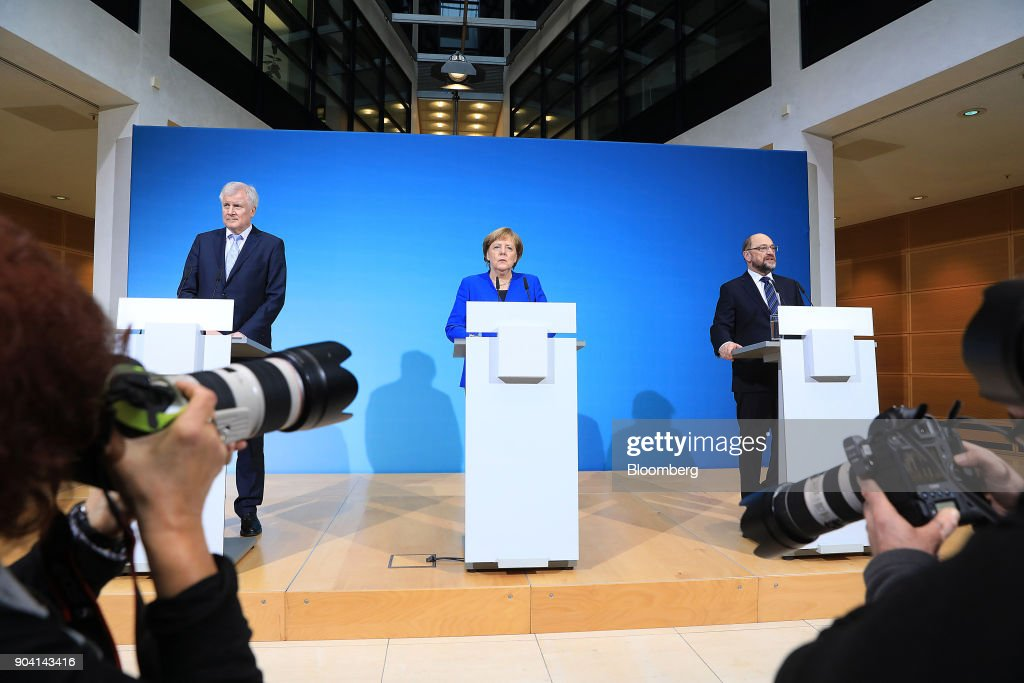 Horst Seehofer, leader of the Christian Social Union (CSU) party, left, and Angela Merkel, Germany's chancellor, center, look on as Martin Schulz, leader of the Social Democrat Party (SPD), speaks during a news conference following overnight coalition negotiations, at the SPD headquarters in Berlin, Germany, on Friday, Jan. 12, 2018. After a marathon of more than 24 hours of talks to end Germanys political gridlock, leaders of Merkels Christian Democratic Union, her Bavarian sister party and the Social Democrats hammered out a 28-page agreement. Photographer: Krisztian Bocsi/Bloomberg via Getty Images